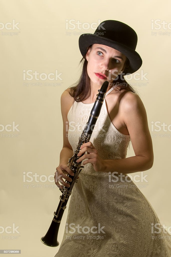 Young Adult Female Clarinetist In Costume stock photo