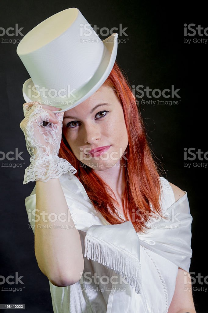 Young Adult Female Doffing Her Top Hat stock photo