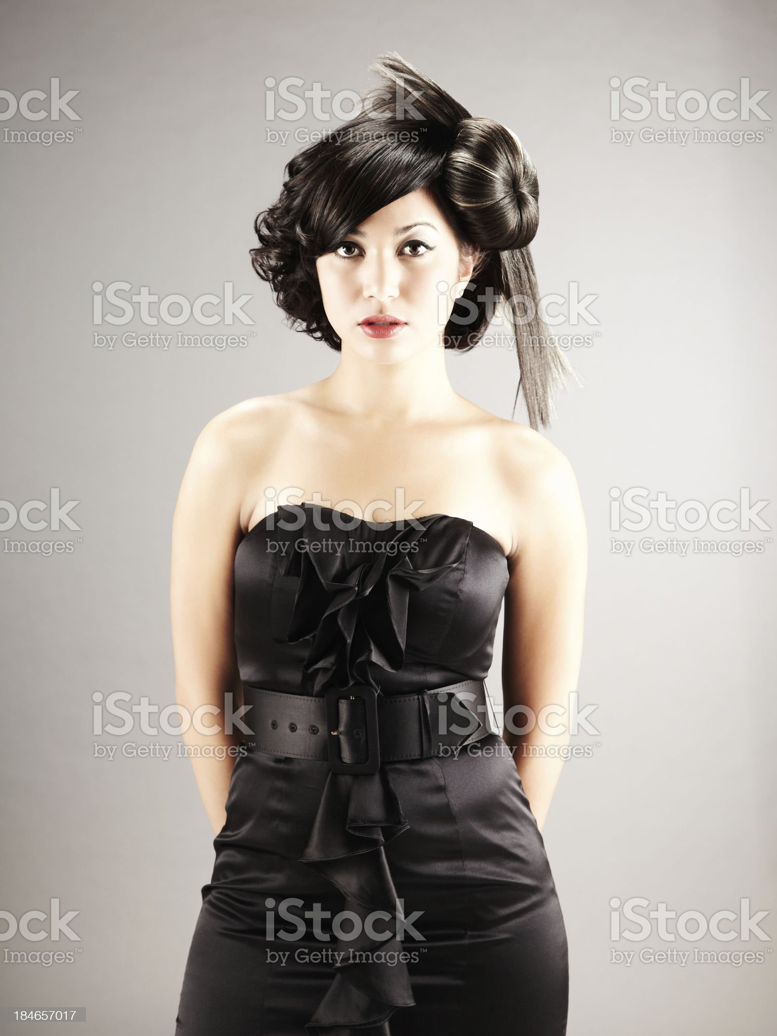 Young adult Female Model in Formal attire looking at camera royalty-free stock photo