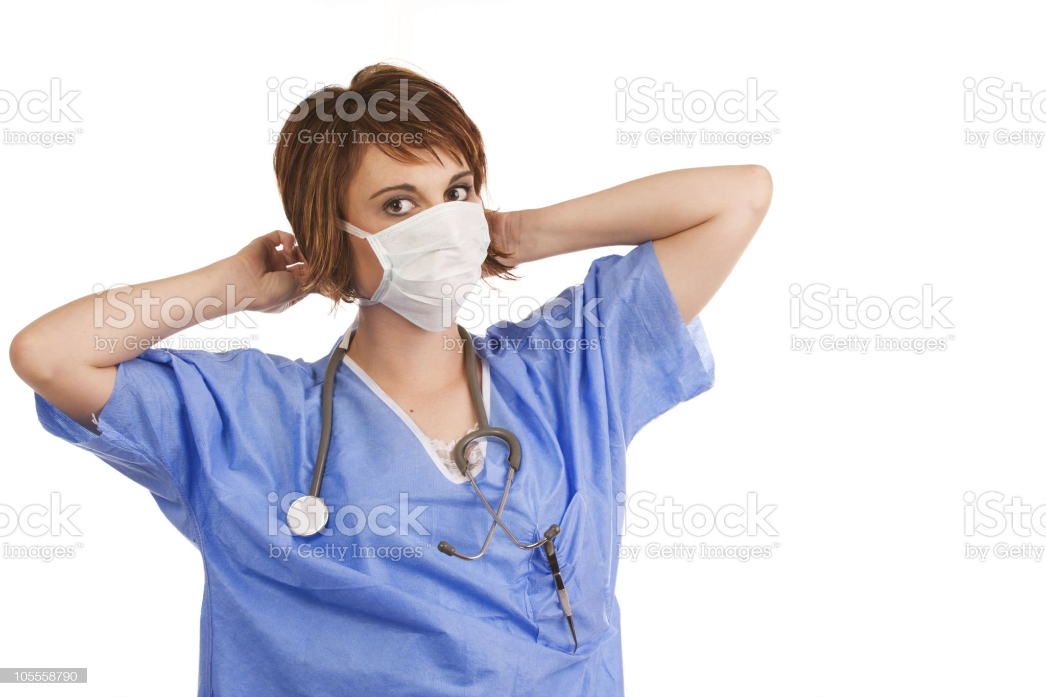 Young adult female nurse prepping for surgery royalty-free stock photo