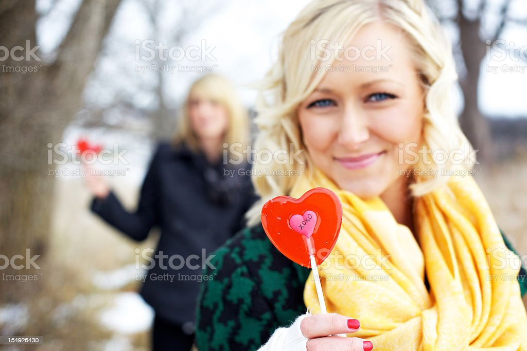 young adult female siblings valentines outdoors stock photo