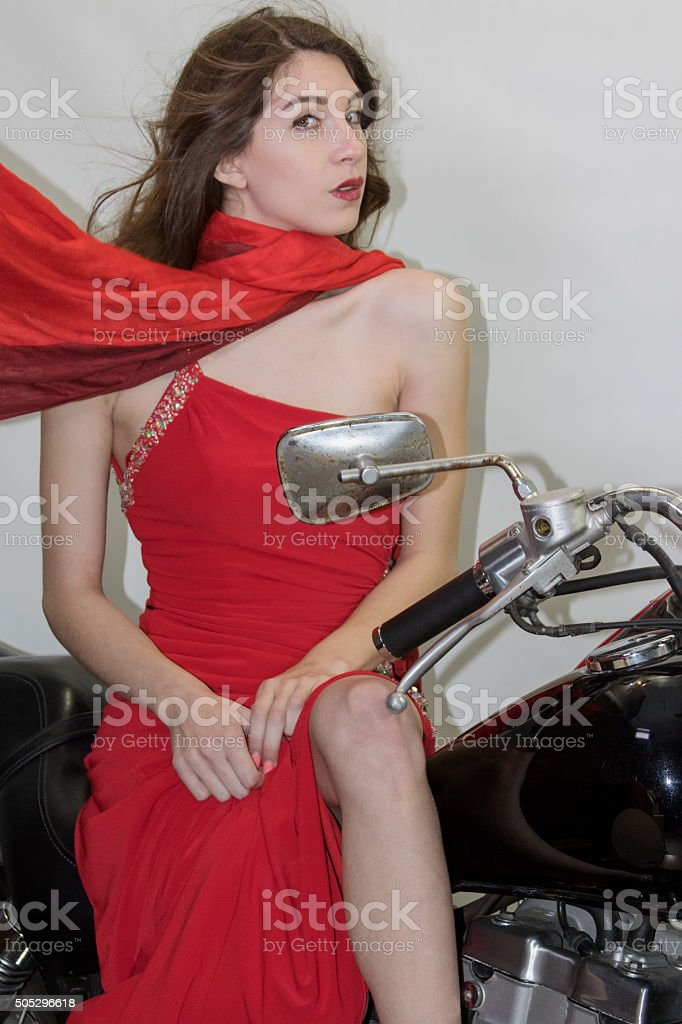 Young Adult Female Sitting On A Motorcycle stock photo