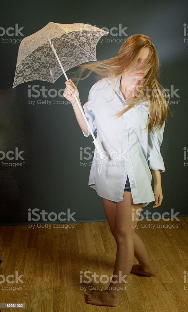 Young Adult Female Walking In The Wind stock photo
