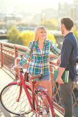 Young adult female with a bike talk to her boyfriend