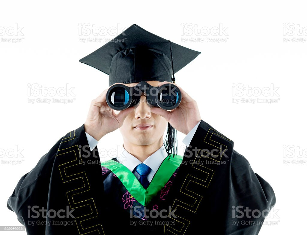 Young adult graduate looking into the future stock photo