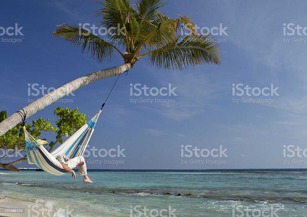 Young adult hammock napping in paradise stock photo