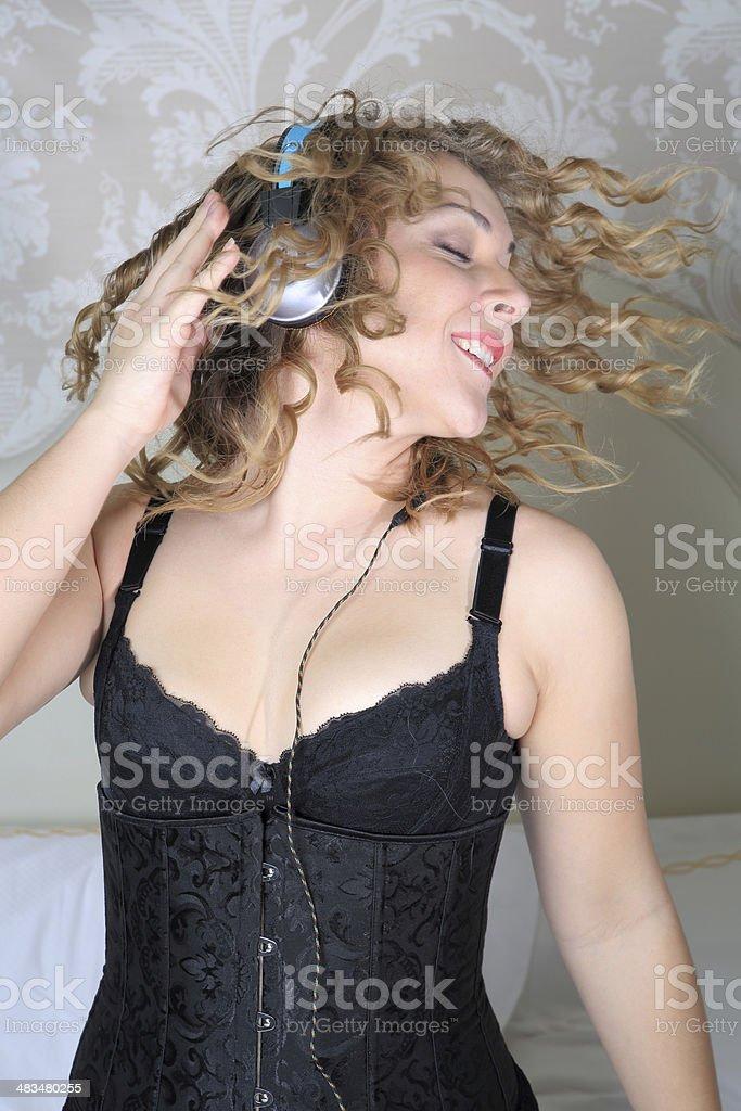young adult headbanging with headphones stock photo