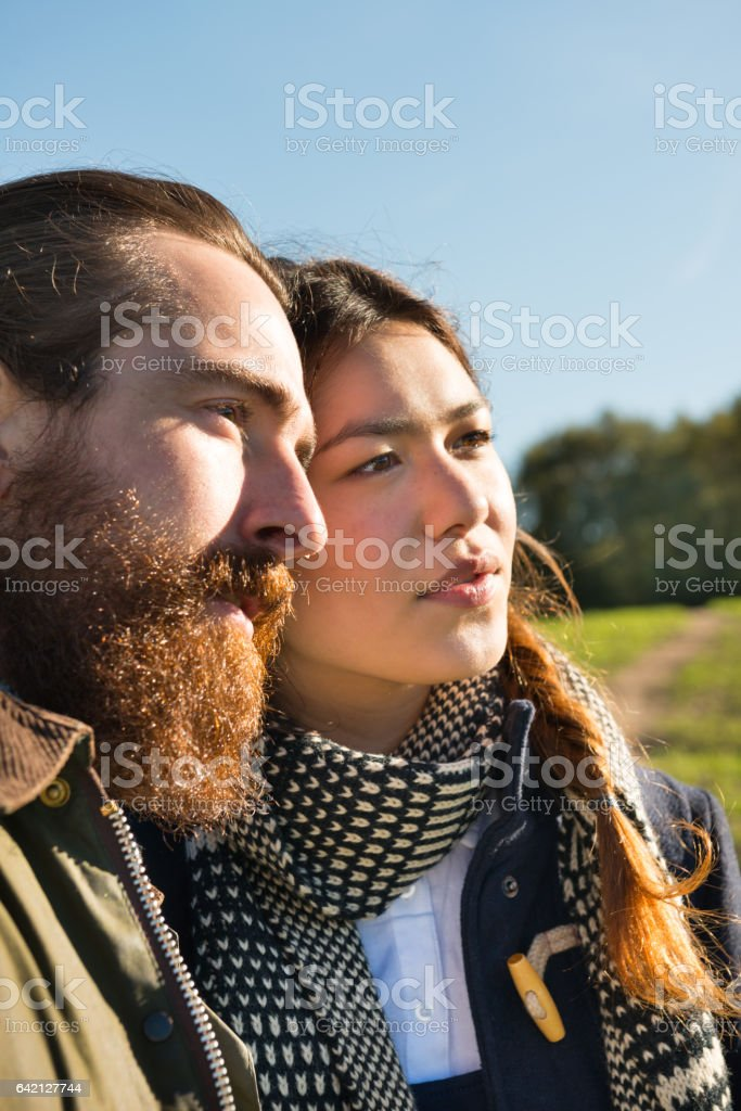 Young adult hipster(s) couple in profile, countryside, bright future stock photo