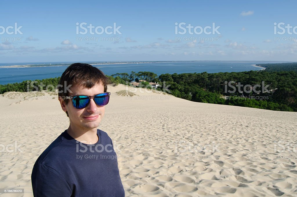 Young adult in a dune stock photo