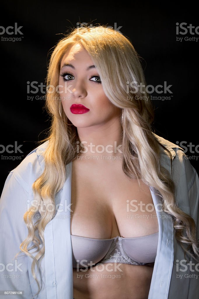 Young Adult In Bra And Open Shirt stock photo