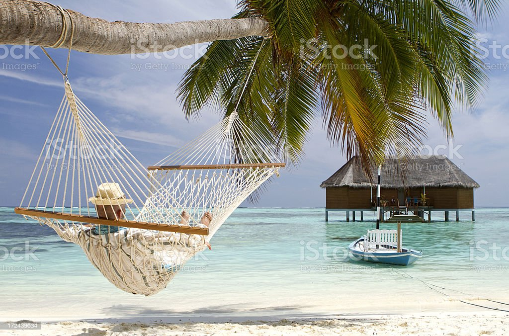 Young adult in hammock contemplating the sea view royalty-free stock photo