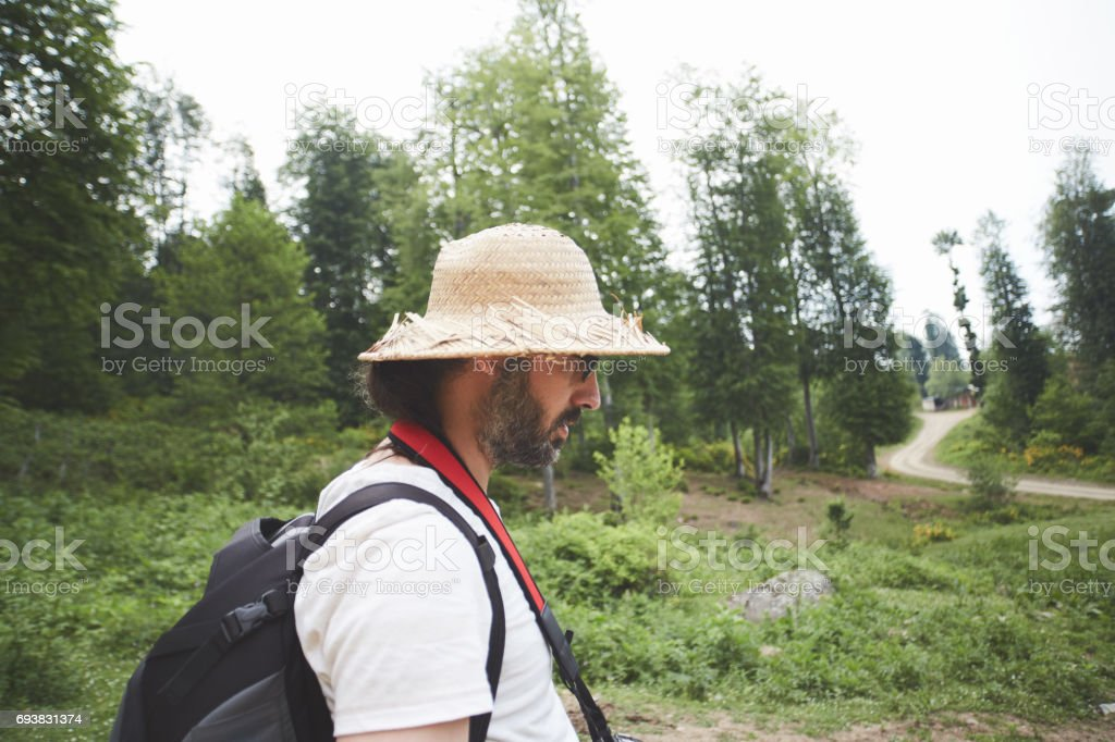 Young adult in search of road in nature stock photo