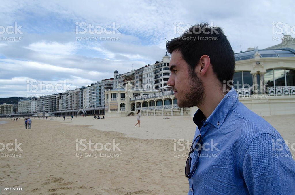 Young adult in the beach stock photo
