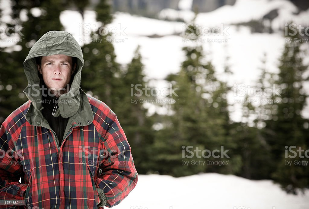Young adult in winter snow royalty-free stock photo