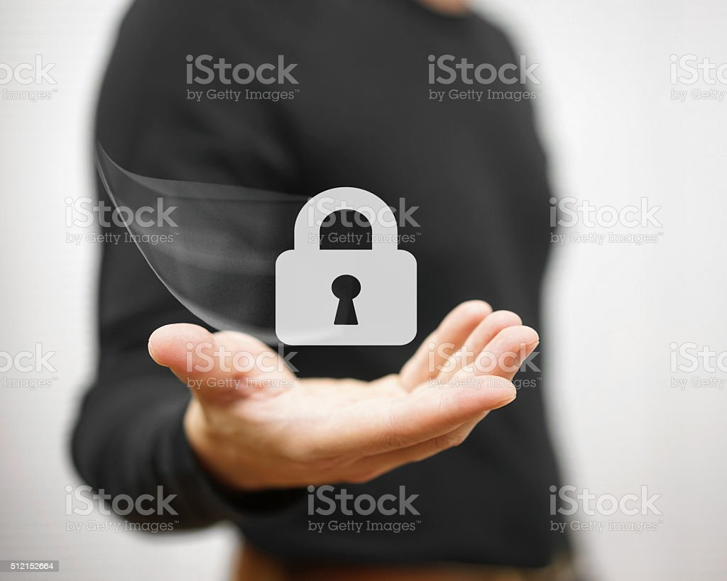 Young adult is holding padlock icon, concept of safety stock photo
