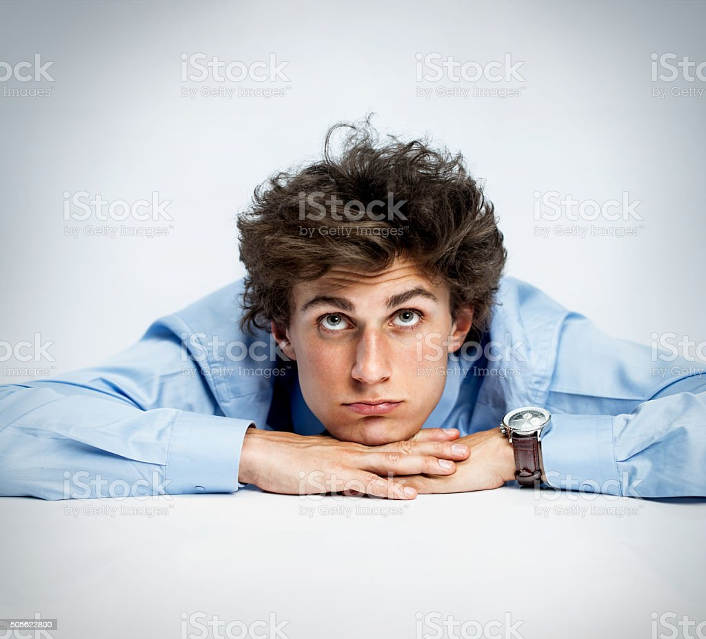 Young adult lost in reverie stock photo