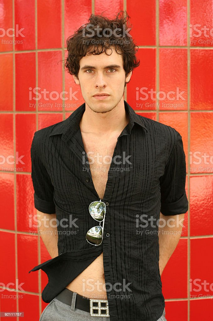 Young Adult Male Model on Red stock photo