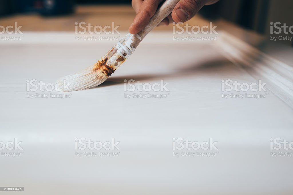 Young Adult Man Painting A Door stock photo