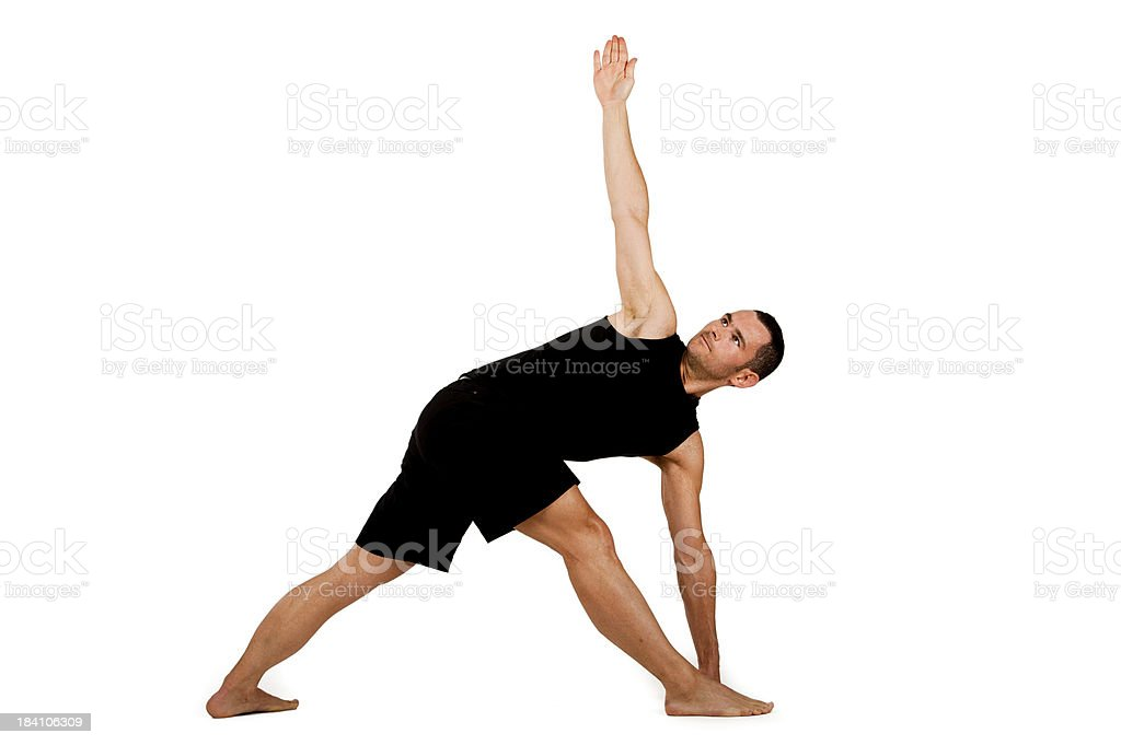 Young adult man practicing yoga royalty-free stock photo