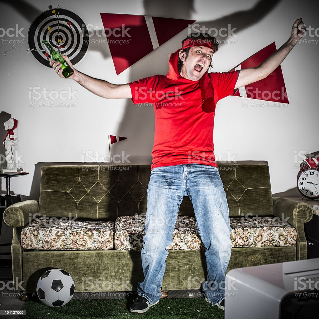 Young adult man watching football on television: Goal! royalty-free stock photo
