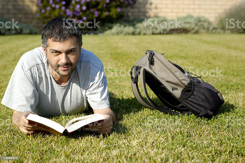 Young adult reading royalty-free stock photo