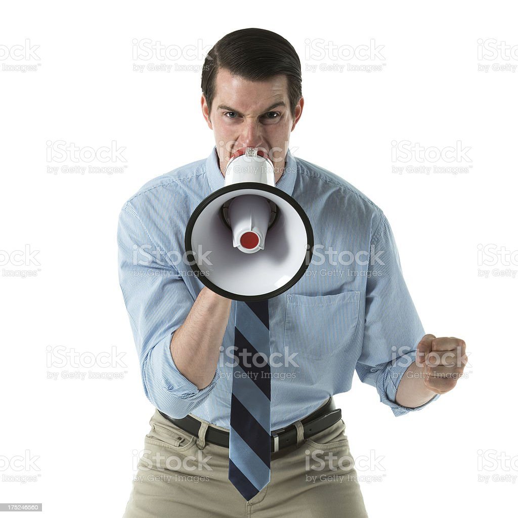 Young adult shouting through a bullhorn royalty-free stock photo