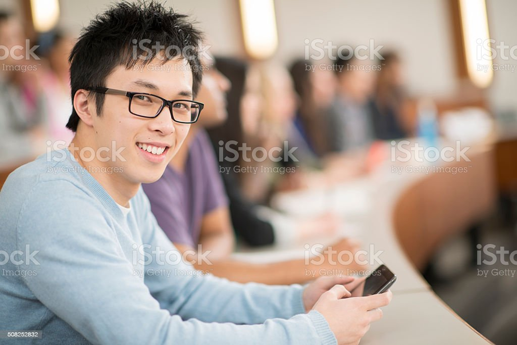 Young Adult Sitting in a College Class stock photo