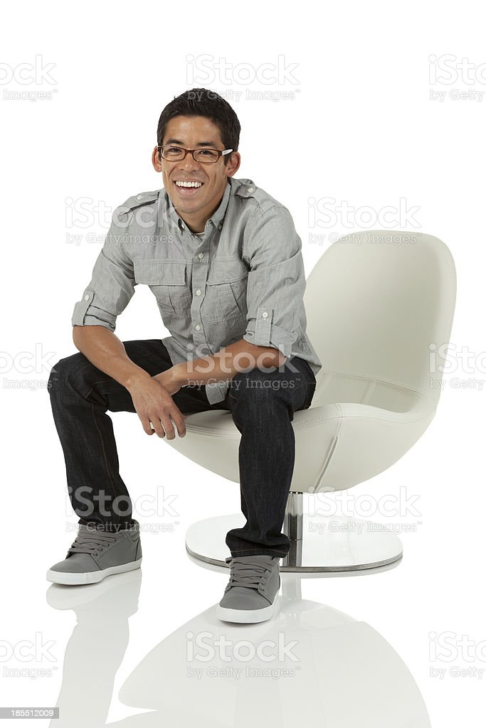 Young Adult sitting on chair royalty-free stock photo