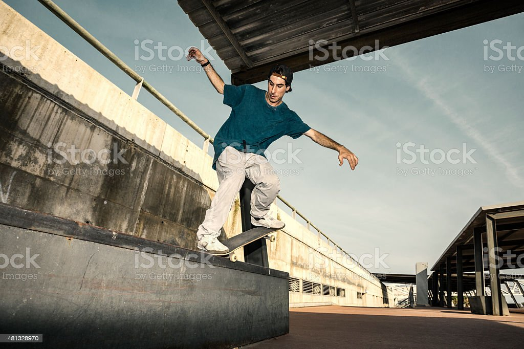 Young adult skating in the city stock photo