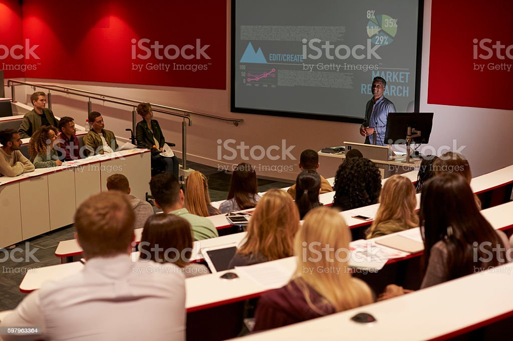 Young adult students at a university lecture, back view stock photo