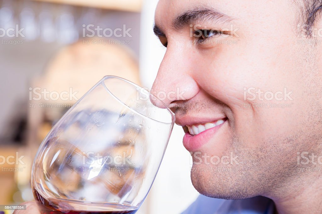 Young Adult tasting wine stock photo