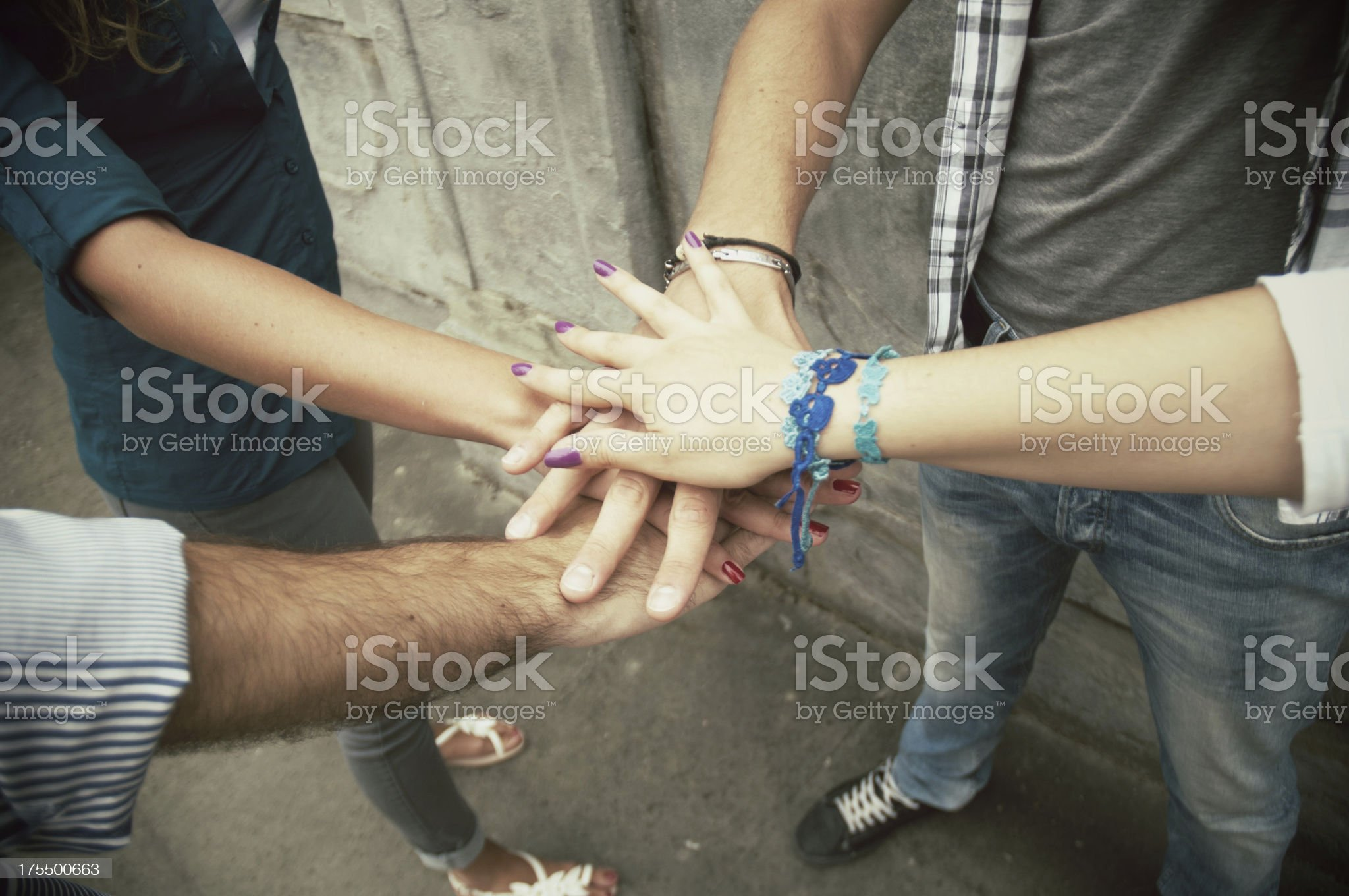 Young adult team joining hands royalty-free stock photo