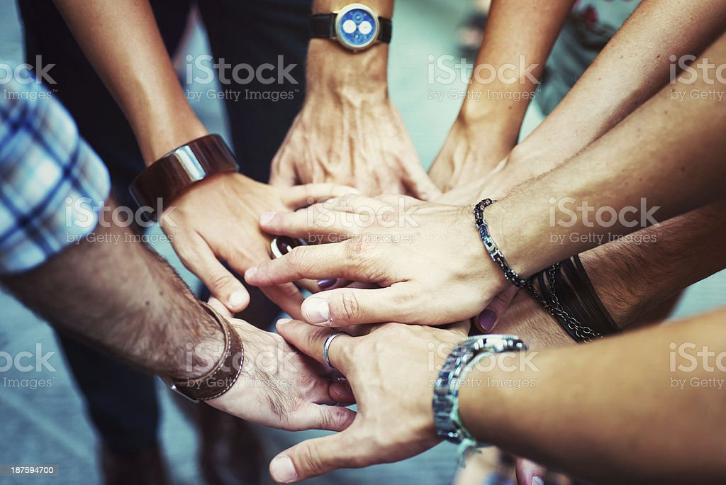 Young Adult Team Joining Hands stock photo
