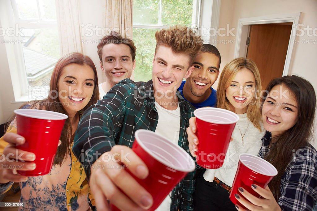 young adult toasting camera stock photo