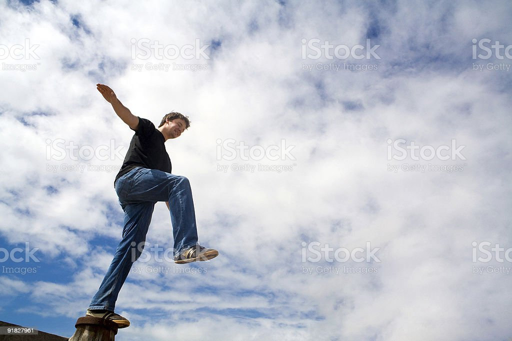 Young adult  trying to find balance stock photo