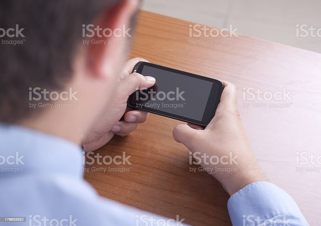 Young Adult using a Smart Phone royalty-free stock photo