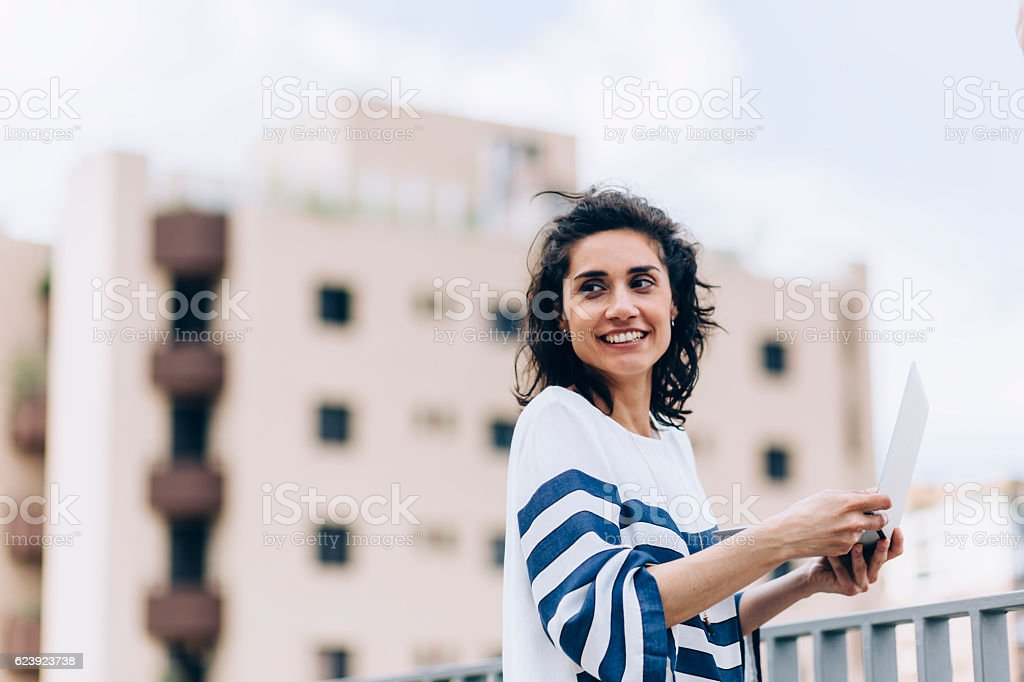 Young adult using notebook stock photo