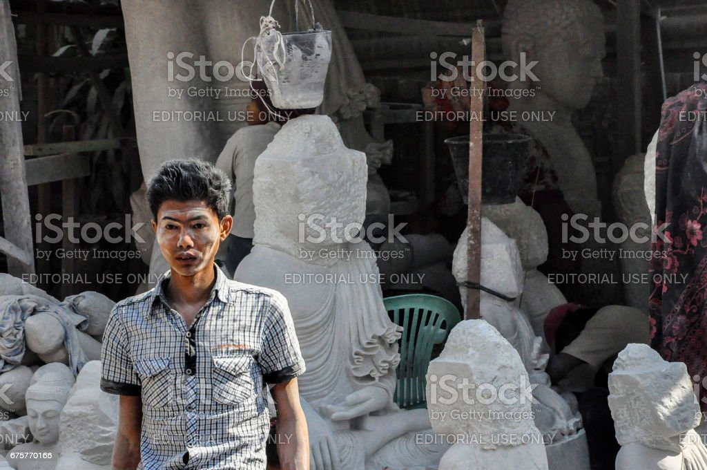 A young adult walking in a village near Mandalay, Myanmar (Burma). stock photo