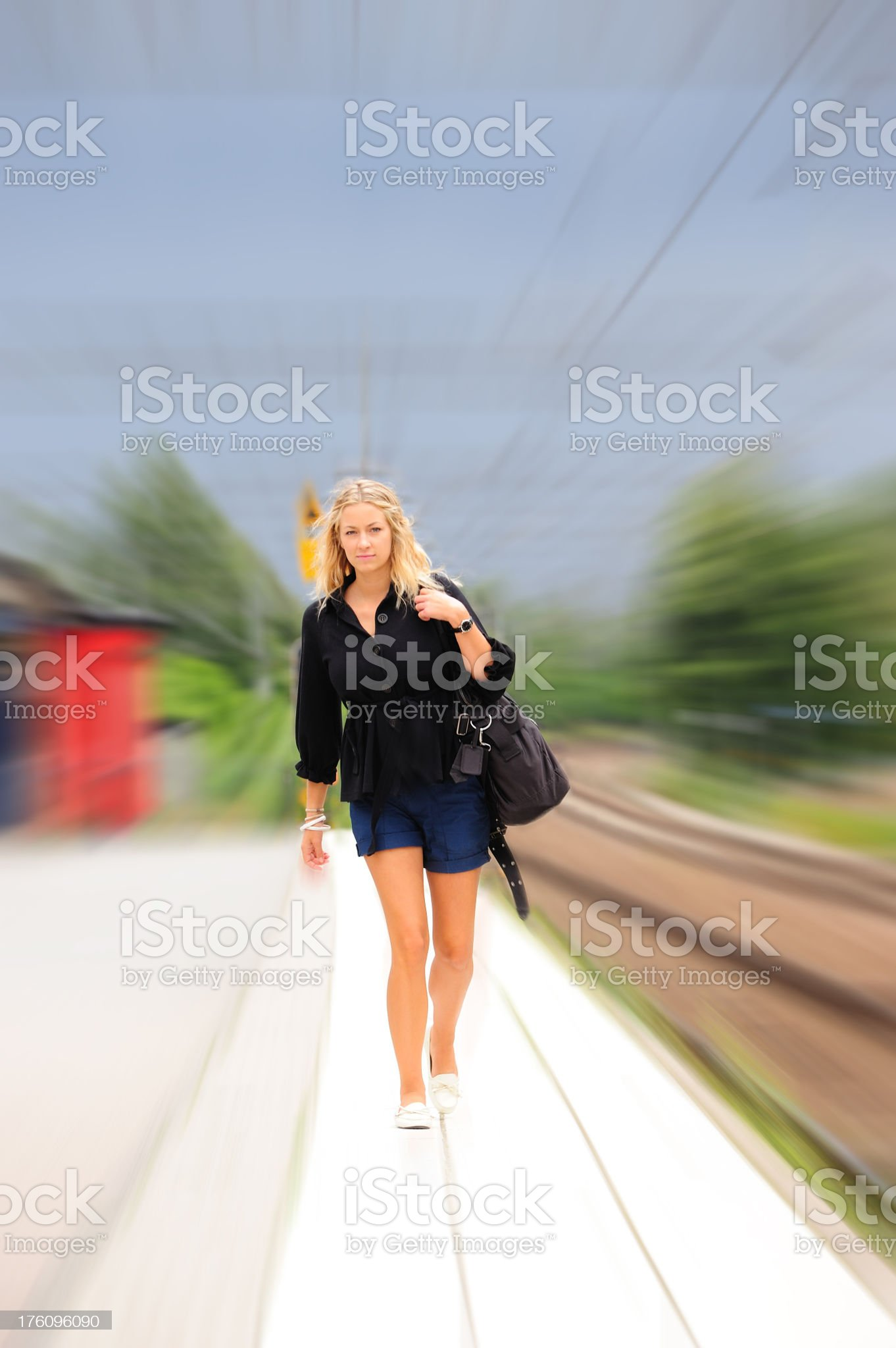 Young adult walking in station platform royalty-free stock photo