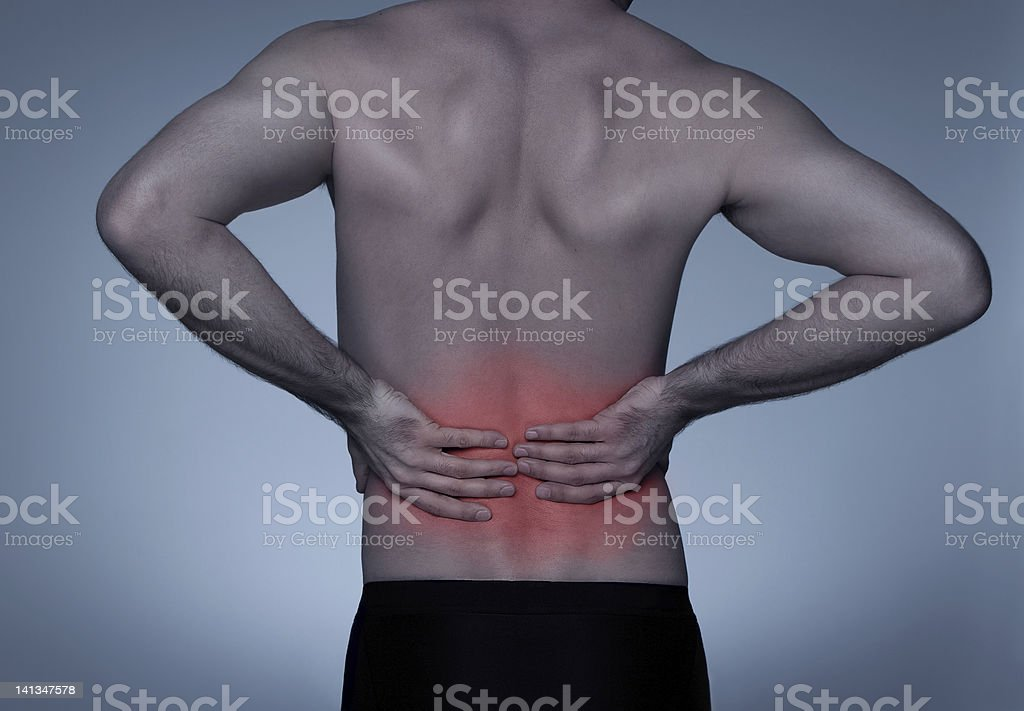 Young adult with backache stock photo