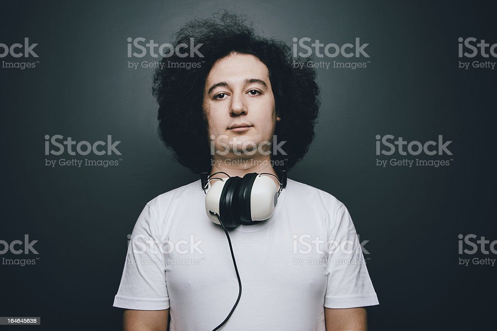 Young adult with headphones royalty-free stock photo