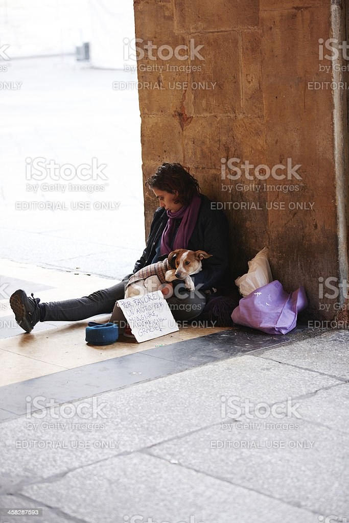 Young adult woman begging in italian city royalty-free stock photo