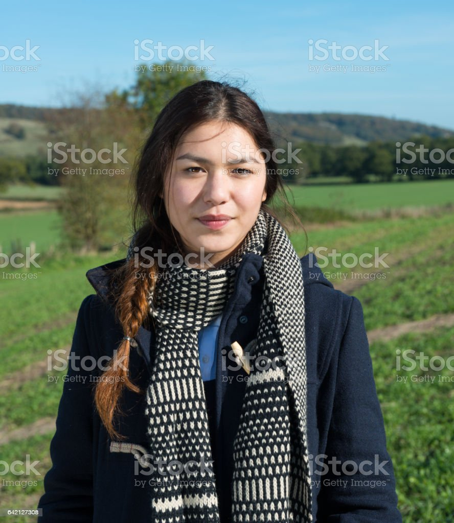 Young adult woman, fields, fall clothes stock photo