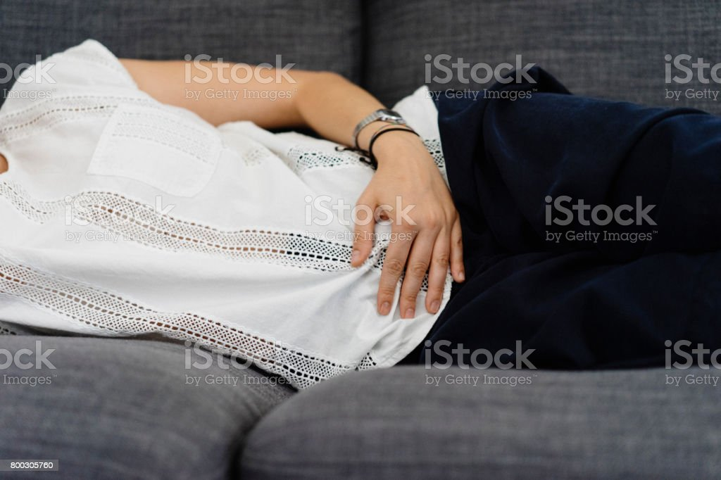 Young adult woman holding her crotch stock photo
