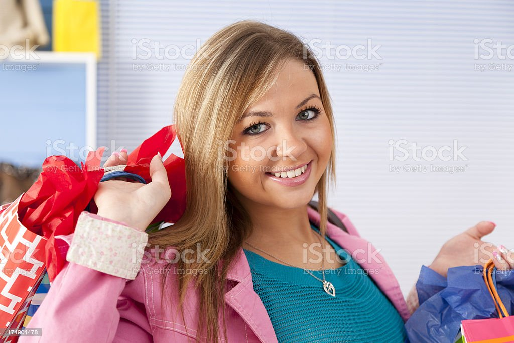 Young adult woman shopping and carrying gift bags royalty-free stock photo