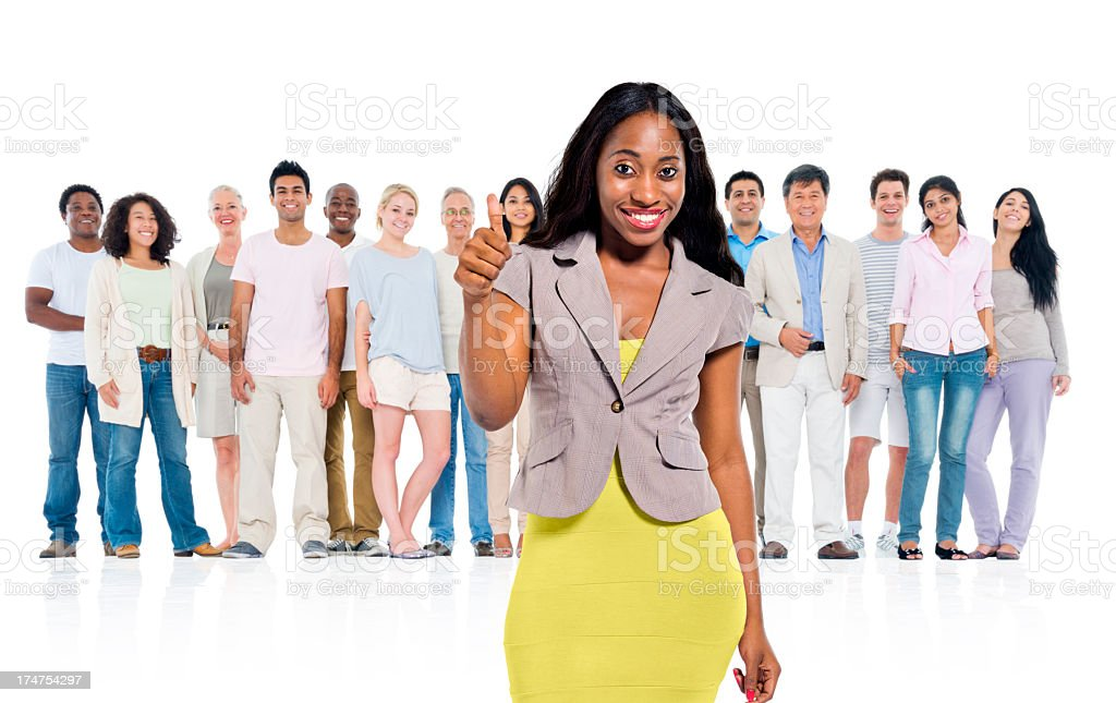 Young adult woman standing out from crowd stock photo