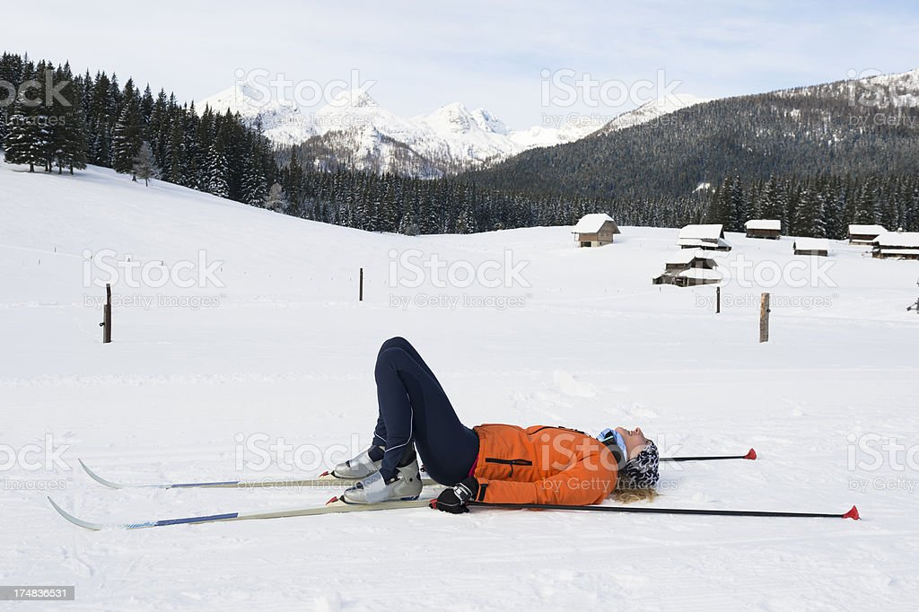 Young adult women at ski rest after long run stock photo