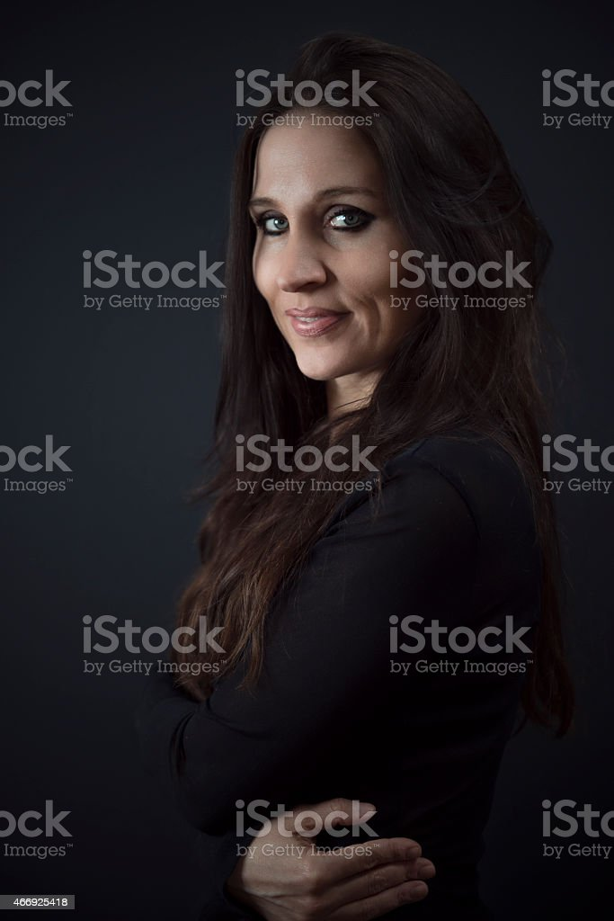 young adult women dark background stock photo