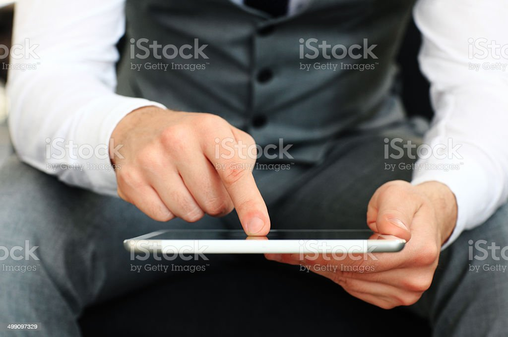 Young adult working on a digital tablet. royalty-free stock photo