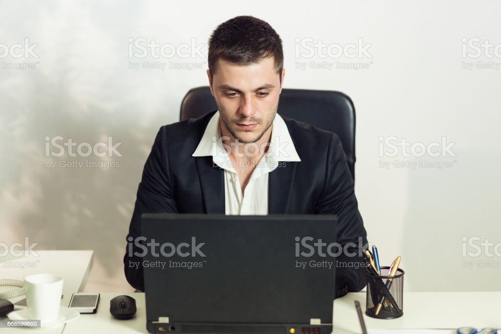 Young adult working stock photo